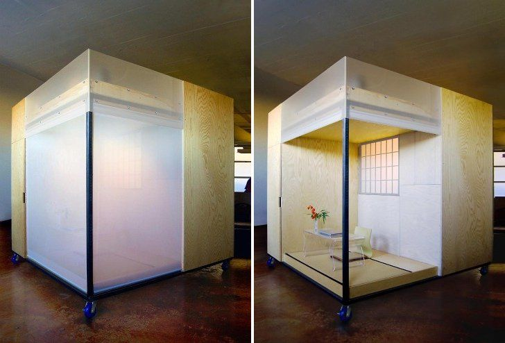 Feng shui expert builds mobile dwelling cube with a living