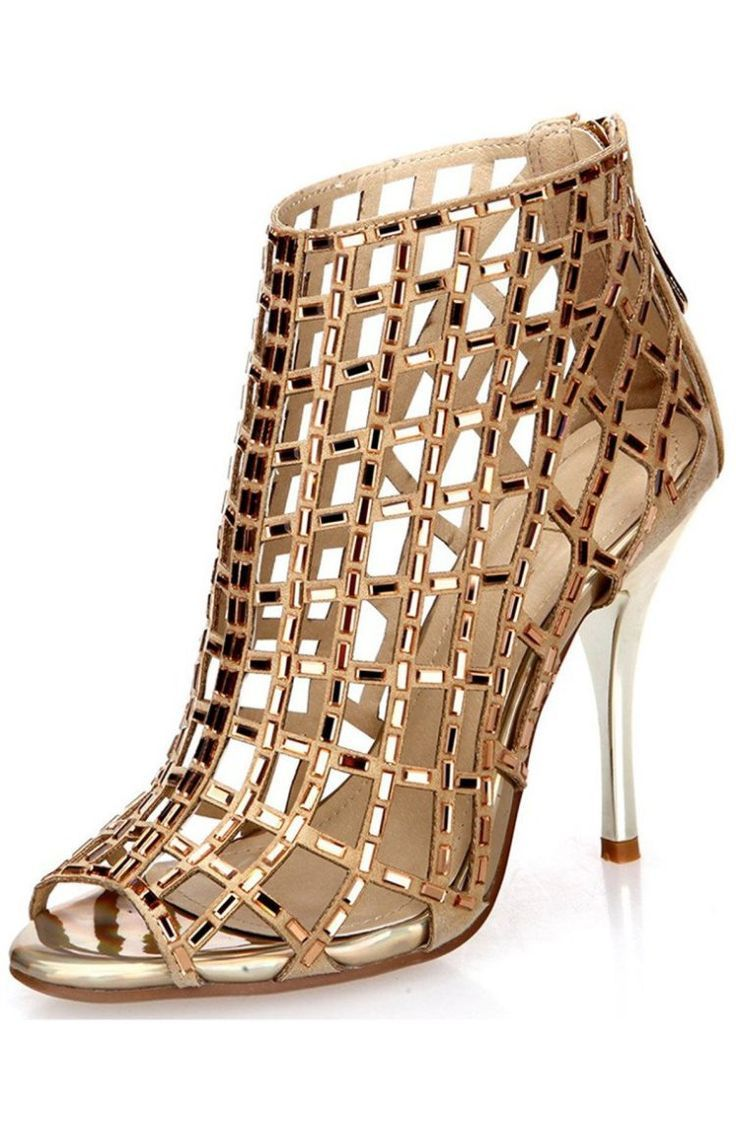 Made from leather and embellished with rhinestones, these laser-cut heels feature a stylish peep-toe. These booties add drama and shine to any ensemble