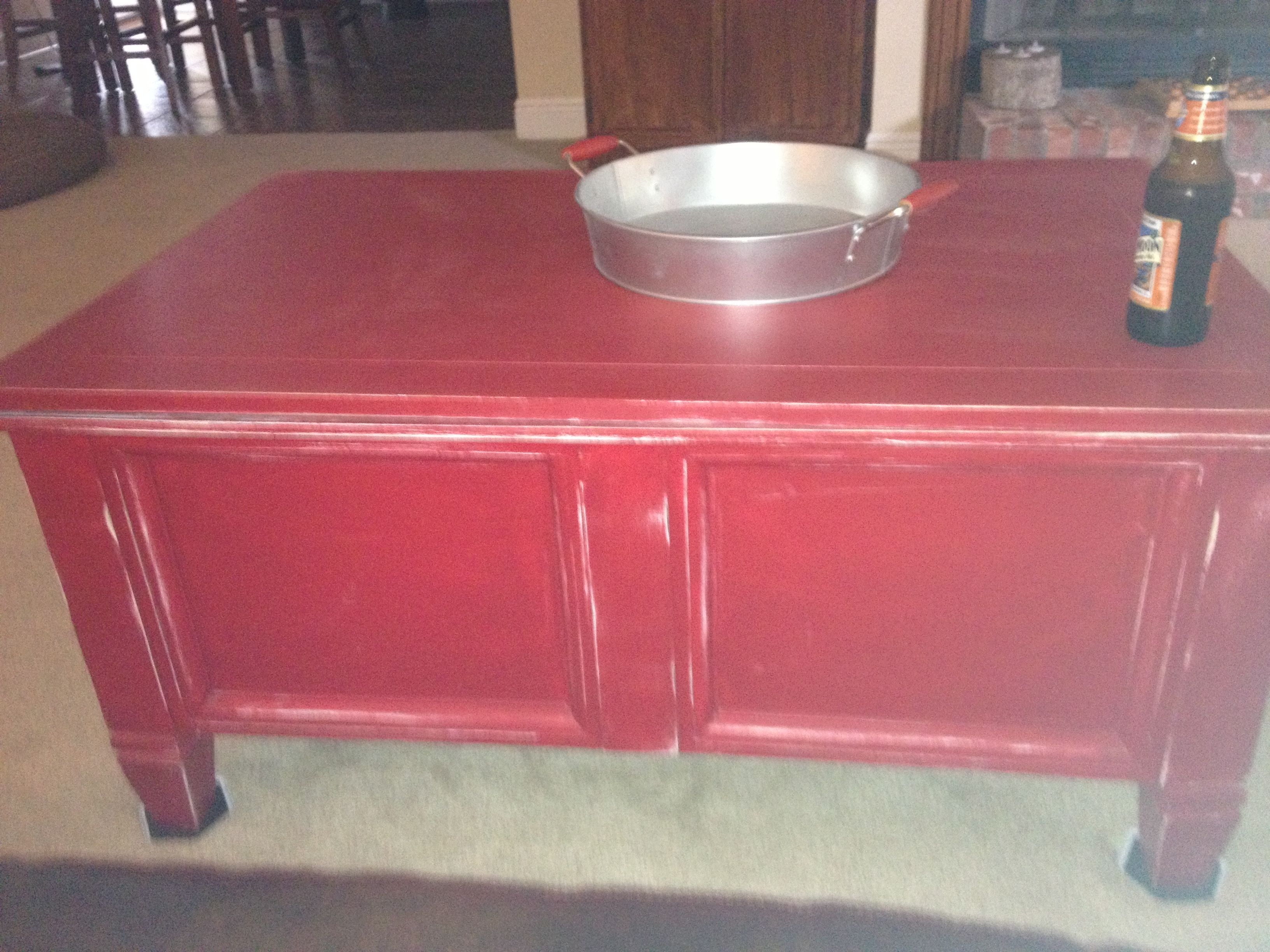 Cedar chest transformed into a barn red distressed coffee table