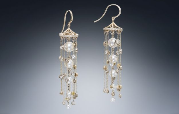 A brand new pair of long drops with yellow and white diamonds, white pearls, and 14K yellow gold. Created by Christopher Duquet Fine Jewelry Design. #earrings #gold #diamonds #pearls