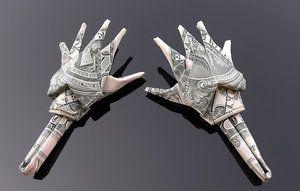 Craigfoldsfives.  Dollar bill oragami-skeleton hands