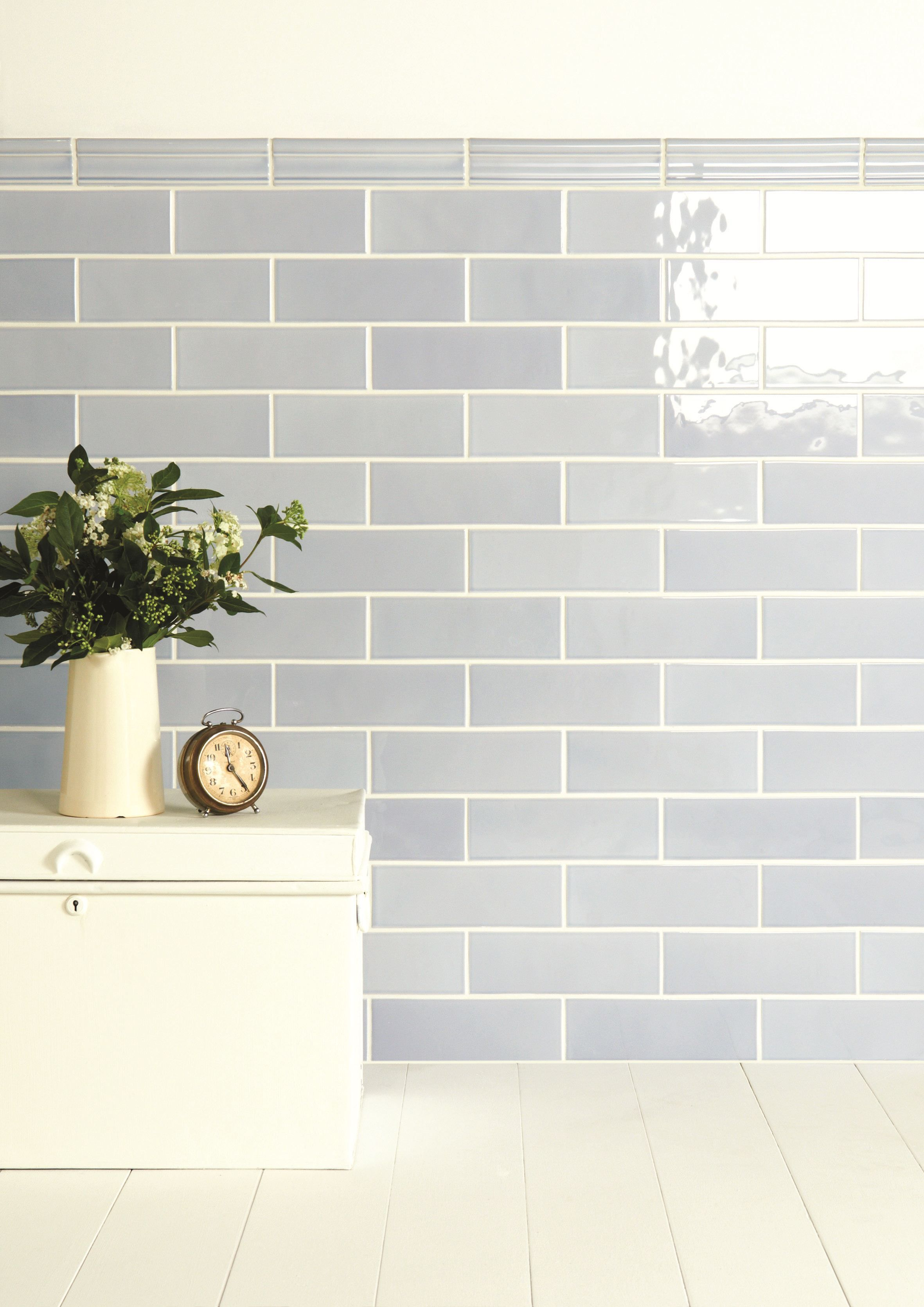 Snape gloss brick wall tiles are a soft shade of blue with subtle