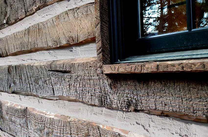 Hand Hewn distressed log cabin siding. Log cabin siding