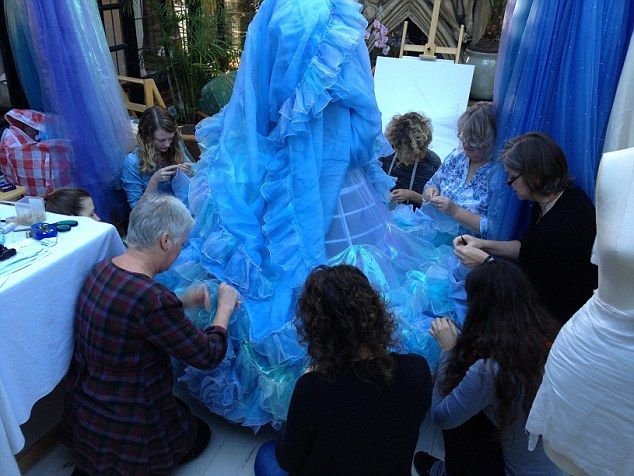 Team effort: The dressmakers work on the petticoat. In total, Lily worea chemise, corset, ...