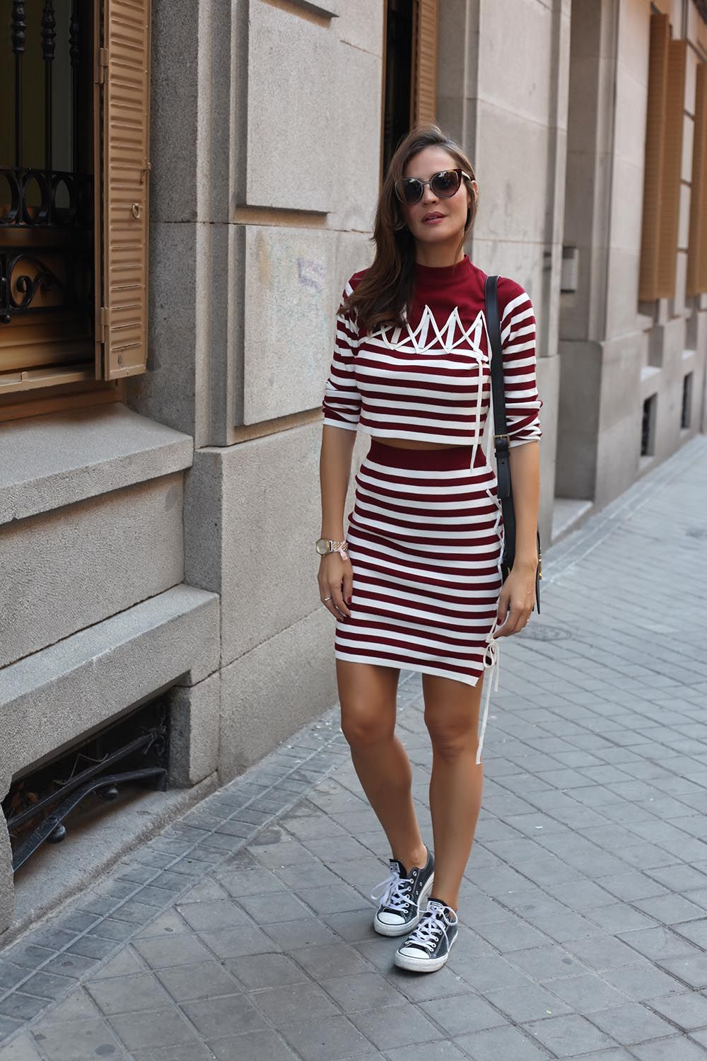 matching stripes looks - Lady Addict. Burgundy striped kintwear long sleeve and skirt+grey sneakers+black shoulder bag+sunglasses. Late Summer Outfit 2016
