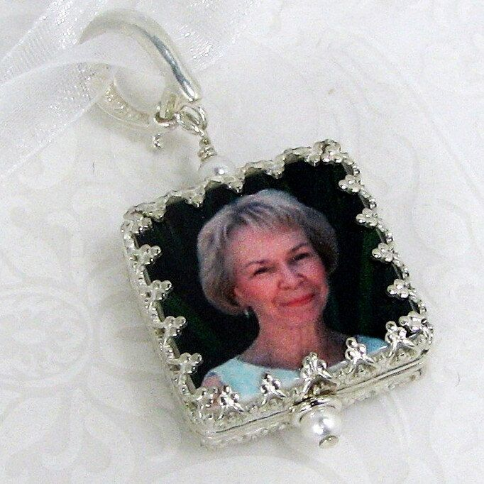 A beautiful two-sided photo charm wrapped in a sterling Princess frame.