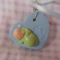 These are tiny little babies on a heart nestled beside a small set of footprints.  A sweet little dangle for a rear view mirror, a wall or just sitting on a shelf :)   Choose the heart color of the one you would like to order.