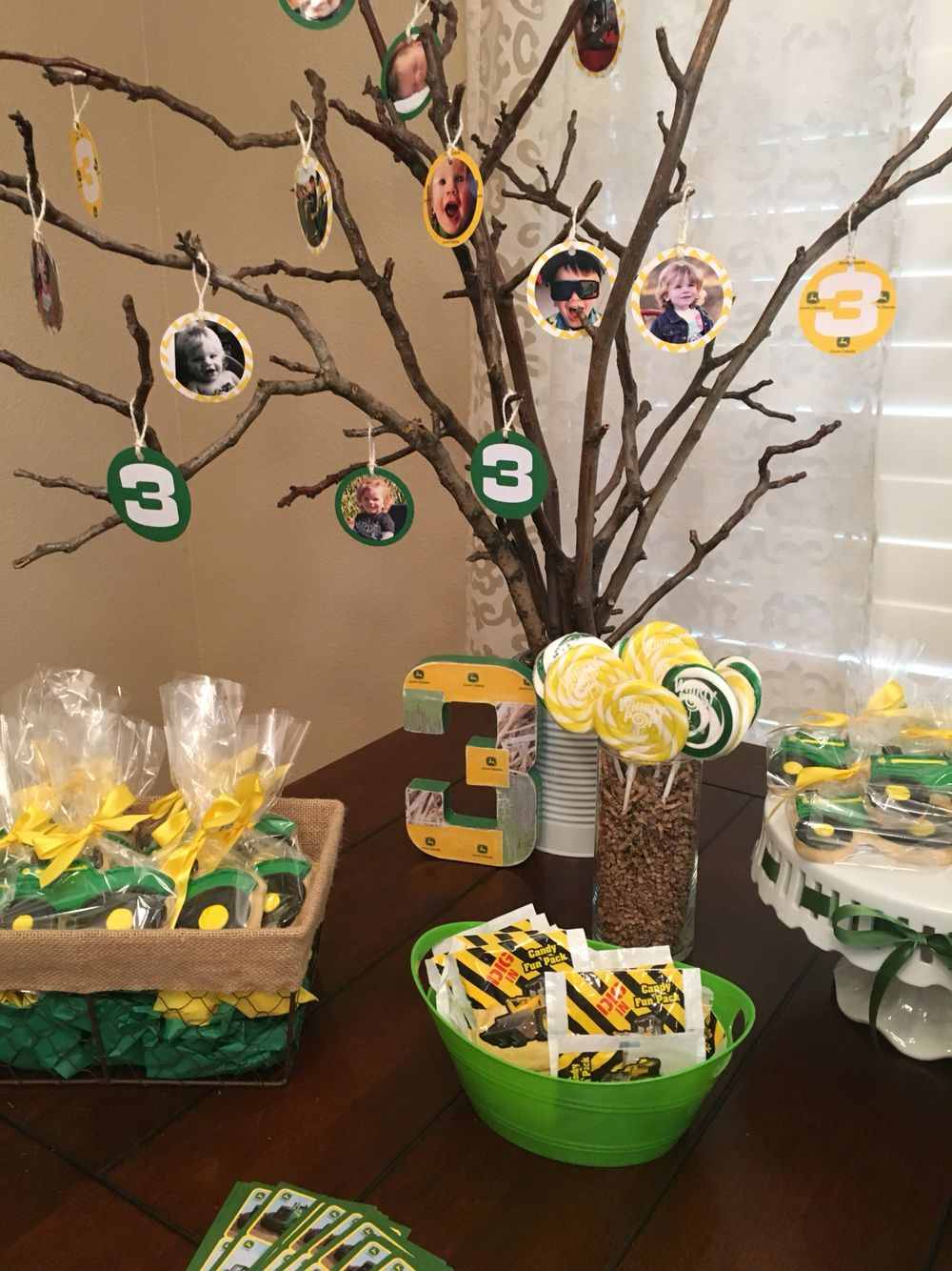 {Sweets table with a little tree full of photo ornaments} • John Deere birthday • John Deere theme party • kids birthday • boy birthday party ideas • green and yellow party colors • tractor birthday • John Deere •