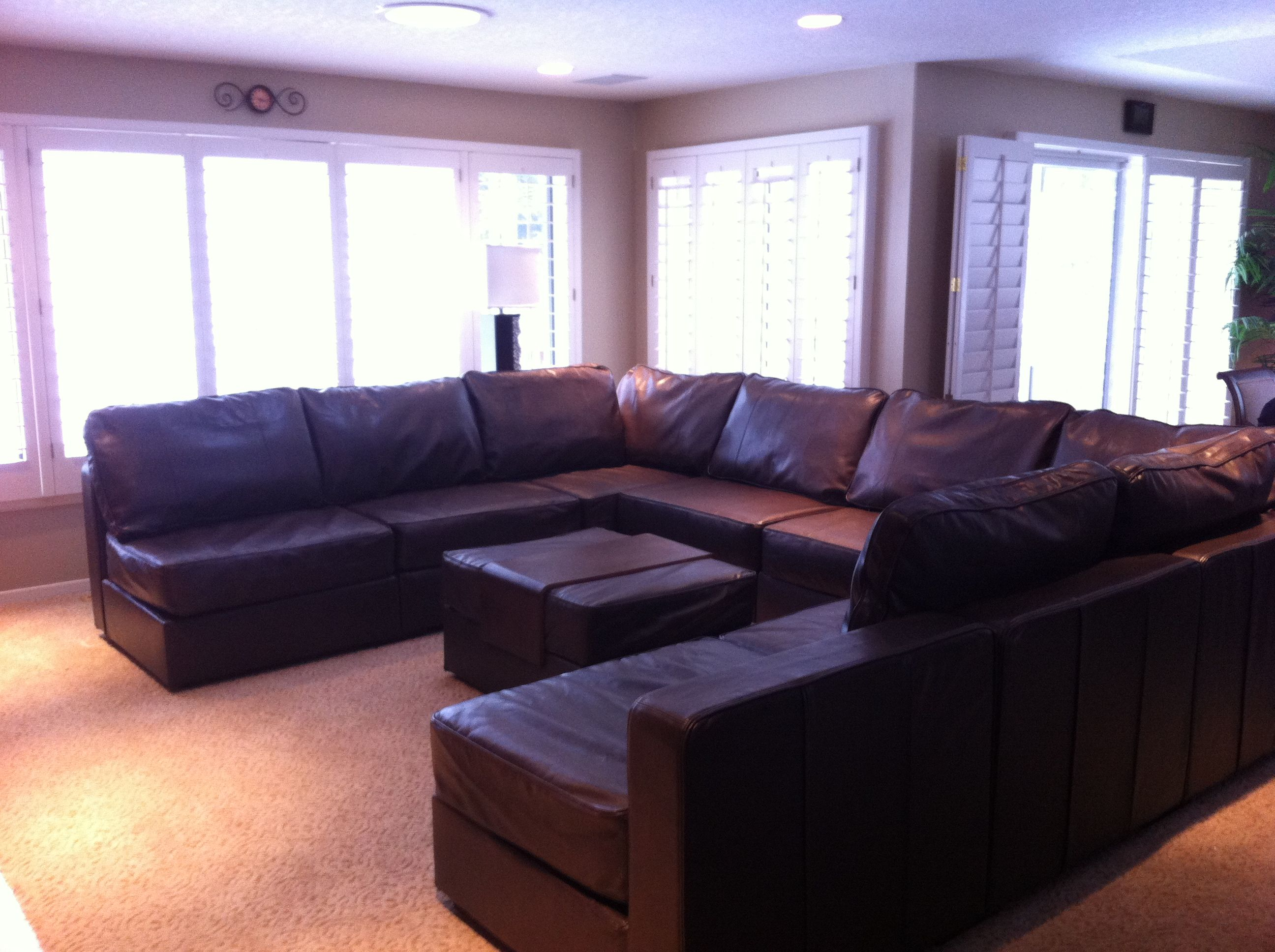 6s Glove Leather U Shaped Couch Set Up With A Matching Ottoman In The Middle Lovesac