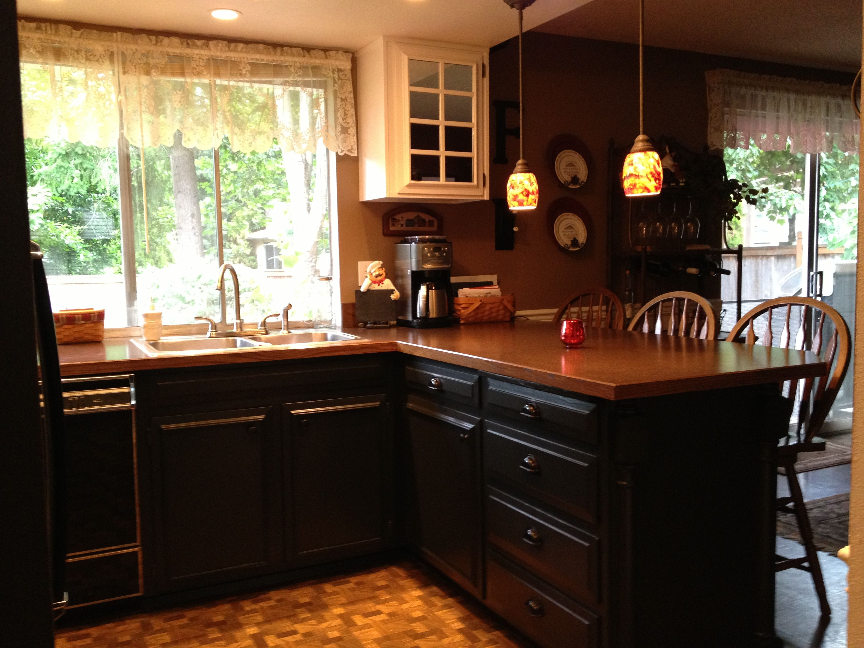 Behr Kitchen Cabinet Paint did it! painted my kitchen base cabinets black. love the dark