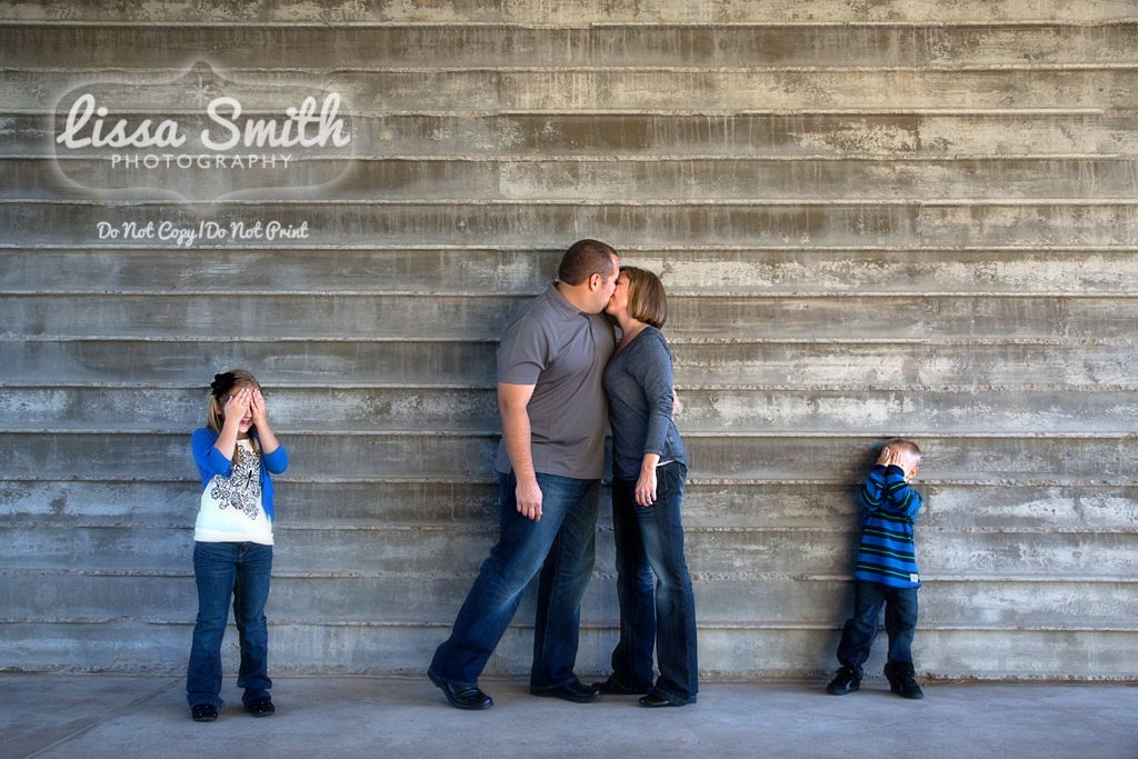 Family portrait ideas mom and dad kissing kids covering eyes dc marketplace