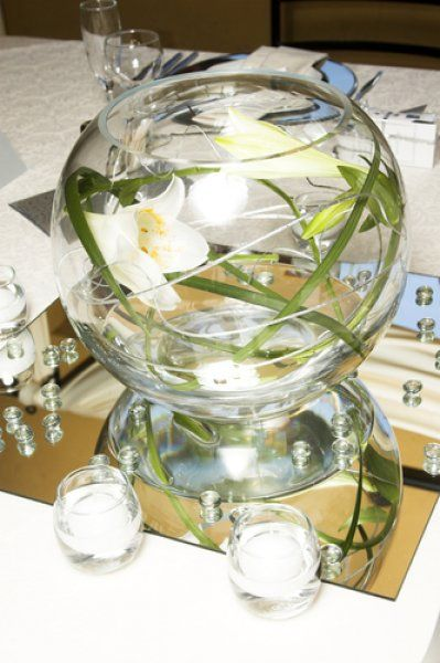 Reception decor featuring round fish bowl style vase with
