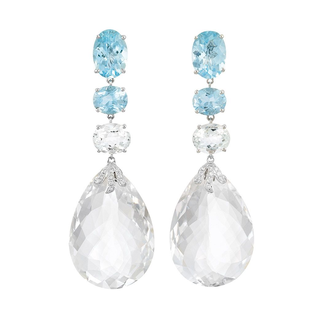 Pair of Aquamarine, Rock Crystal and Diamond Pendant-Earclips 18 kt., topped by a line of 6 oval aquamarines approximately 26.00 cts., suspending 2 rock crystal briolettes approximately 92.35 cts., accented by 20 small round diamonds.