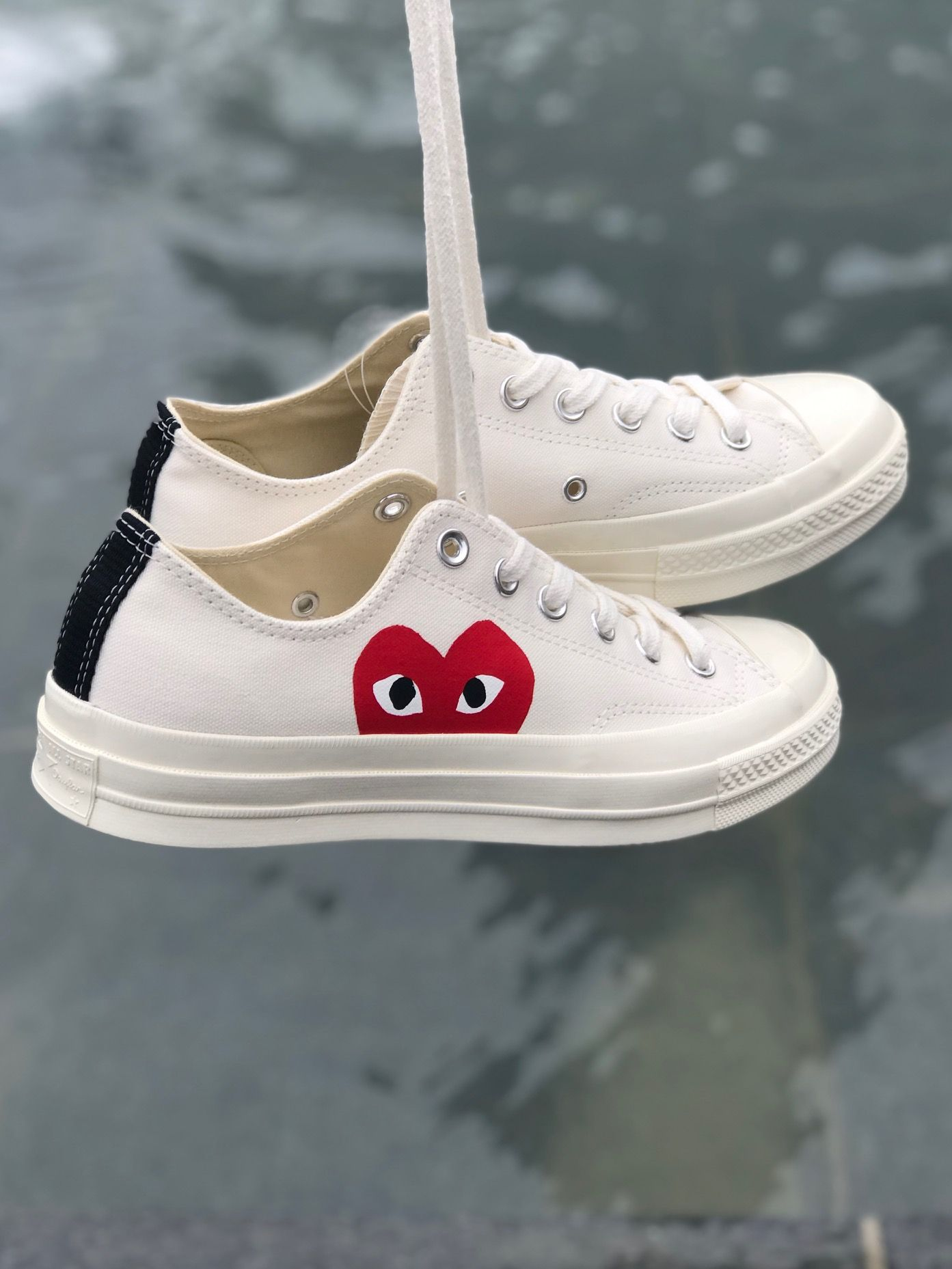 05c3247ce156 SHOP ONLINE - COMME DES GARCONS PLAY x Converse off-white canvas Chuck  Taylor 1970 s