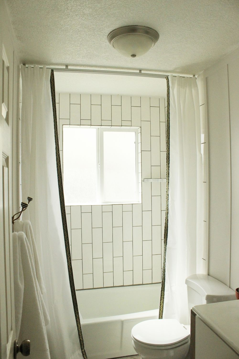 Glass Shower Curtains How To Install A Ceiling Mounted Shower Curtain Diy Projects