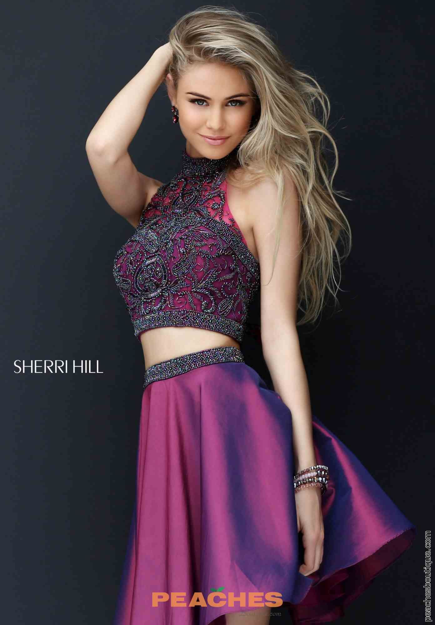 Rock this fashion forward two piece Sherri Hill homecoming dress 50524  featuring a beaded halter crop top and short taffeta skirt and have all  eyes on y.