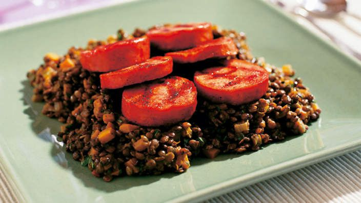 Barbecued pork sausage with spiced lentils recipe : SBS Food