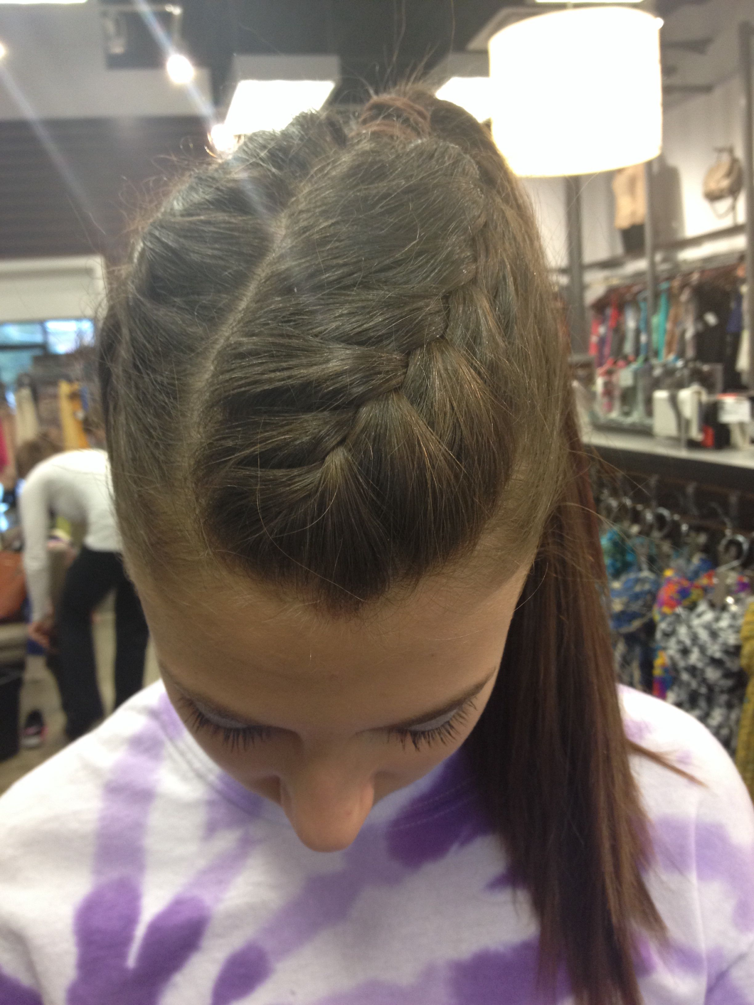 cheer hair: braided on 2 sides with high ponytail