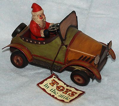 DEPT 56 TOYS IN THE ATTIC CHRISTMAS SANTA in Tin Car Roadster.  Purchased 2013