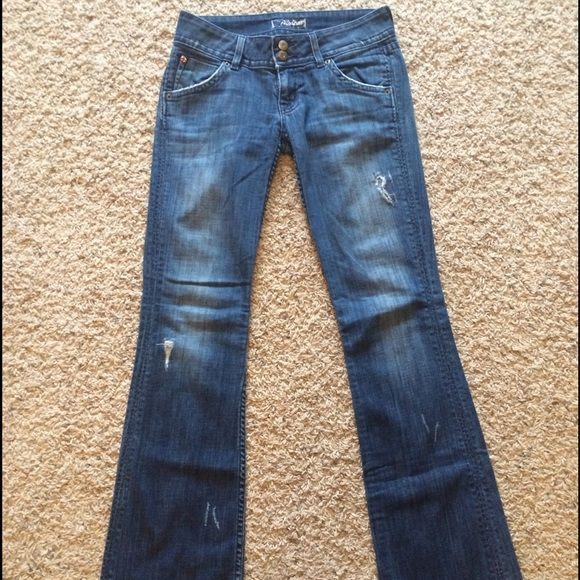"""Hudson boot cut jeans Distressed boot cut style. Super soft denim with multiple distressed areas. One area could use a patch (shown in picture) these are hemmed with original hem and have a 31"""" Inseam. Small wear area on bottom of hem on back of jeans. Otherwise in great condition! My favorite jeans... But two kids later and then are just too snug! Hudson Jeans Jeans Boot Cut"""