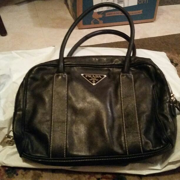 """This bag has 2 straps Its a black color  With light brown stiching Its 9 """" long And 12""""wide  Fabulous condition  I never used it. Has a zipper pocket on the  inside. Nice enough, to hold more things. MAKE OFFERS IF YOU LIKE"""