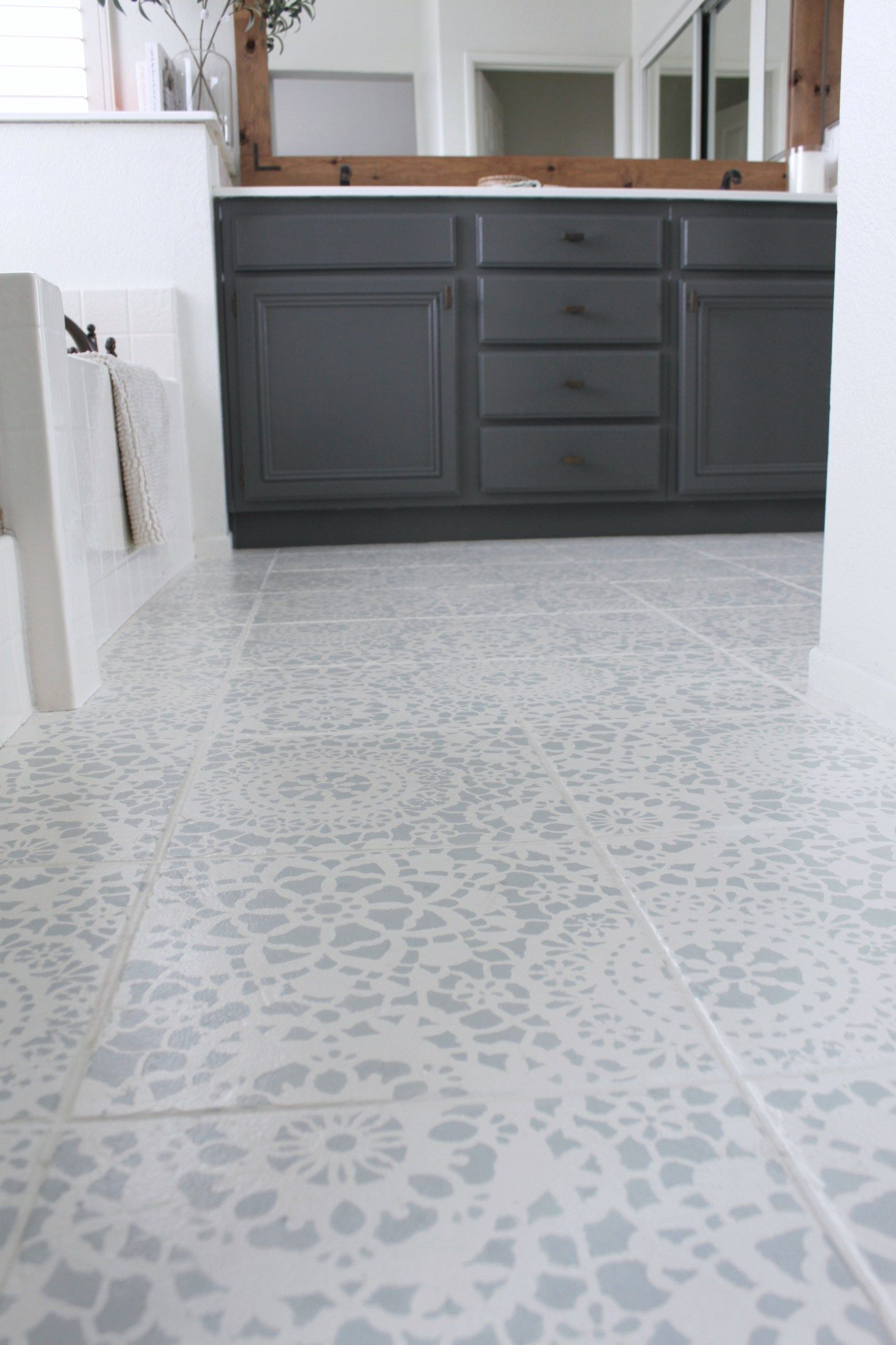 Stencil Tile Floor Update is part of Stenciled tile floor, Painting tile floors, Painting tile, Bathroom flooring, Tile bathroom, Tile floor - Stencil Tile Floor Update top US DIY blog, Domestic Blonde, shares an update on how their Bathroom Stencil Tile Floor is holding up over time  Click here!