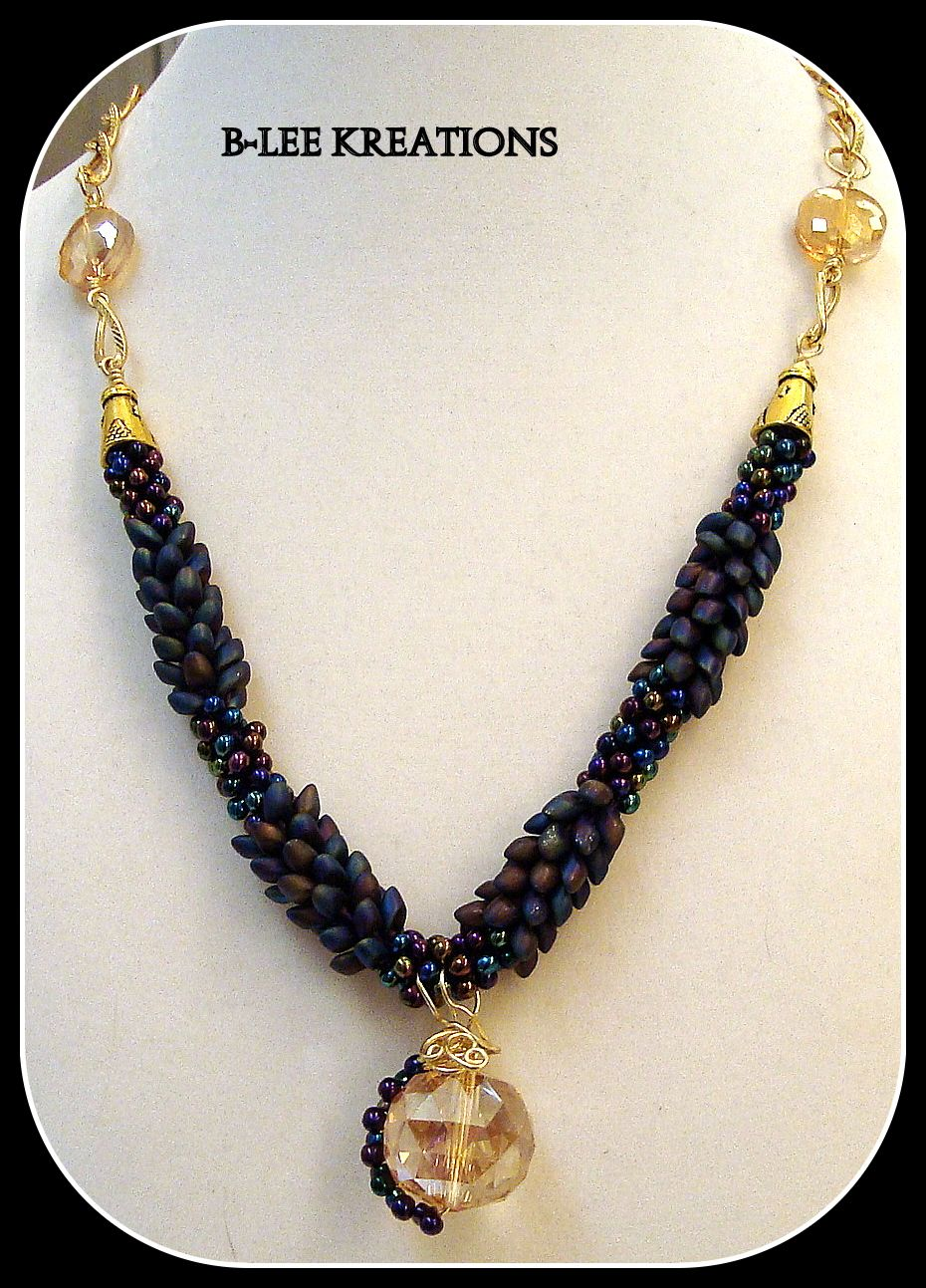 This is a Kumihimo necklace I made and added chain and crystals.
