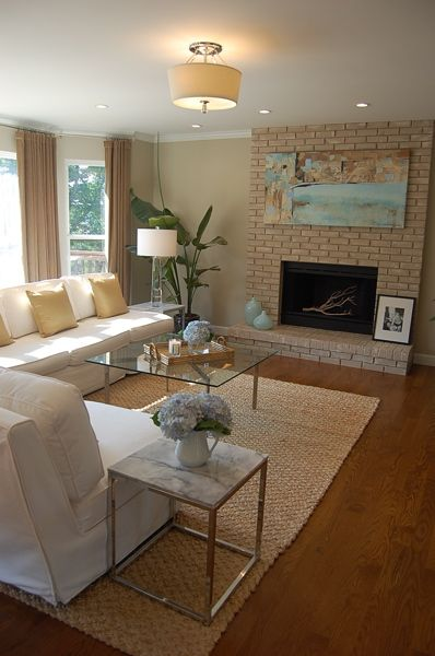 So Pretty Gold Throw Pillows Yellow Brick Fireplace And Love The Benjamin Moore Grant Beige Wall Yellow Living Room Living Room Colors Trendy Living Rooms