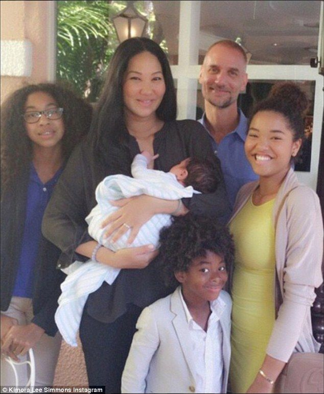Kimora Lee Simmons and Tim Leissner take son Wolfe for a stroll