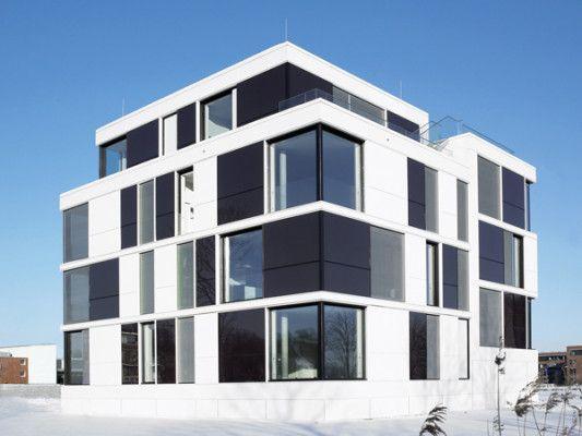Holzverkleidung Fassade Arten sonderform fassaden mit integrierter photovoltaik fassade