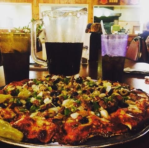 A small pizza parlor in Louisville, KY, that serves your drink in a pitcher. Great pizza I might add.