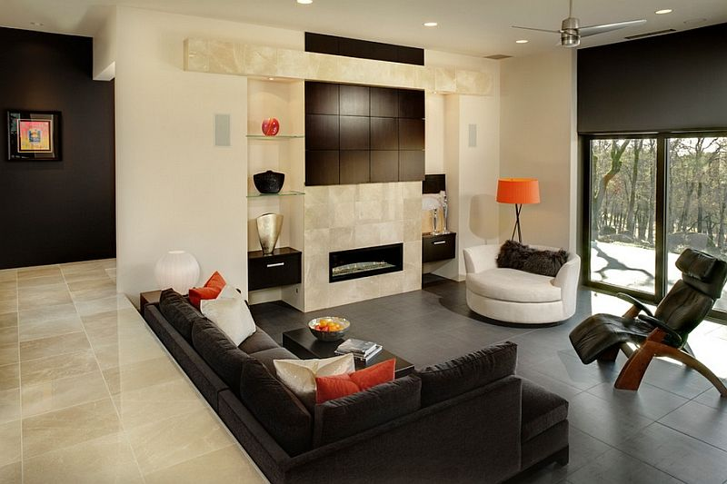 Luxurious Decor And Bright Pops Of Orange Create A Cozy Step Down Living Space  C B Sunken