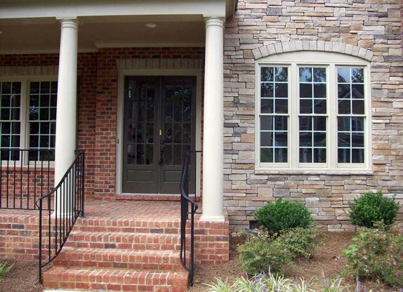 House Front Steps | Brick Steps Leading To Lovely Porch With Iron Rails And Double  Door .