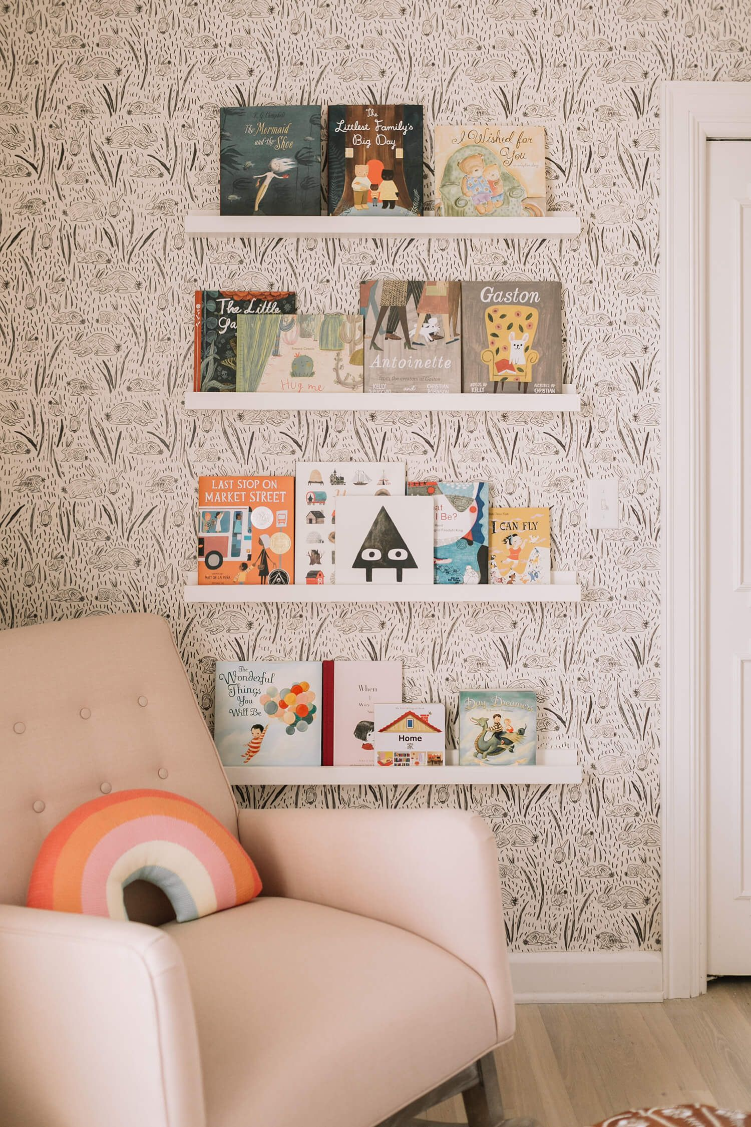 Cozy kids reading corner for a playroom or bedroom. Love the patterned  wallpaper and the