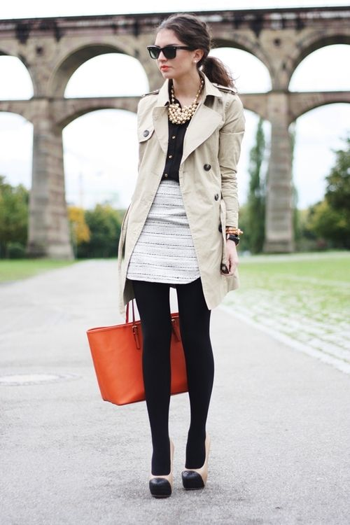 trench coat, black blouse, white skirt, gold bauble necklace, orange tote, black cap-toed nude platform pumps