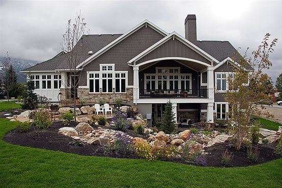 Big Covered Porch Above The Walk Out Basement Doors And Hot Tub With Lots Of Landscaping Ce Custom Home Builders Home Builders House Exterior