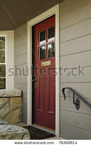 A Red Wooden Front Door To A Home With Four Window Panes In The Top Half Of It There Is A Low Sto Wooden Front Doors Exterior House Colors Painted Front