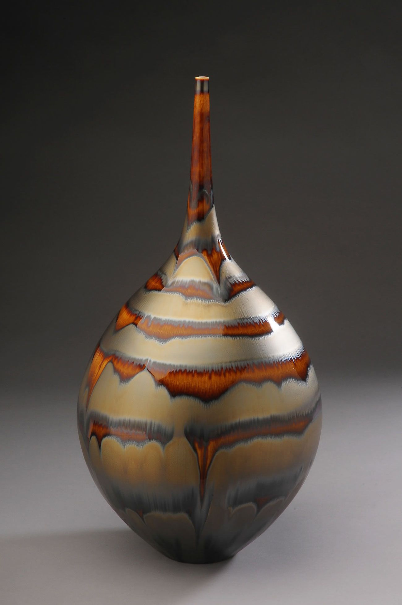 A wheel thrown high fire porcelain work with gold and brown glaze ceramics and glass cfile contemporary ceramic art a wheel thrown high fire porcelain work with gold and brown glaze by hideaki miyamura reviewsmspy