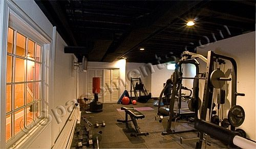 Basement gym ideas. I like the black ceiling it makes the
