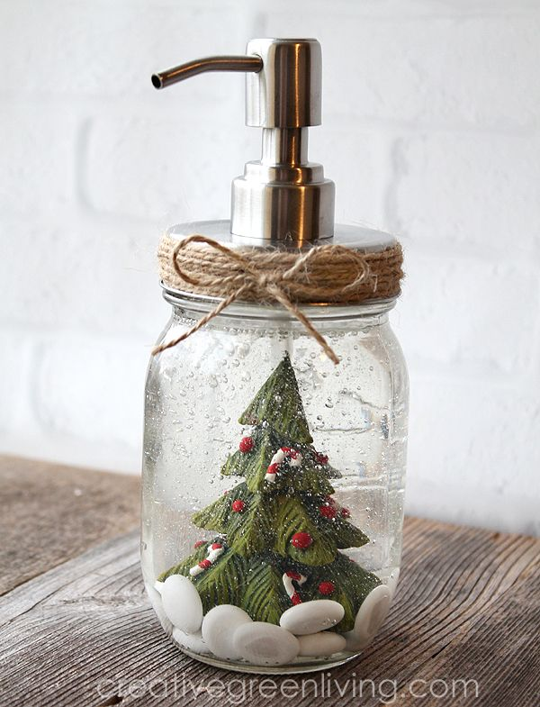 how to turn a mason jar into a snow globe soap pump dispenser just in time for christmas creativegreenliving masonjar soappump snowglobes christmas