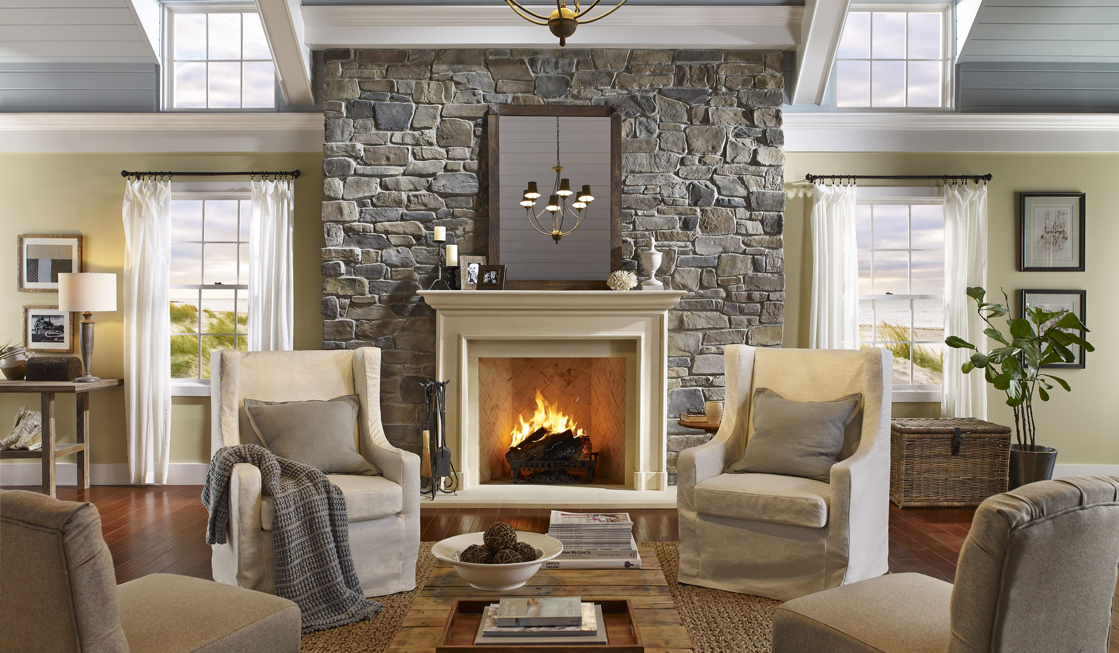 Coastal Living Room With Stone Fireplace And White Crown Molding