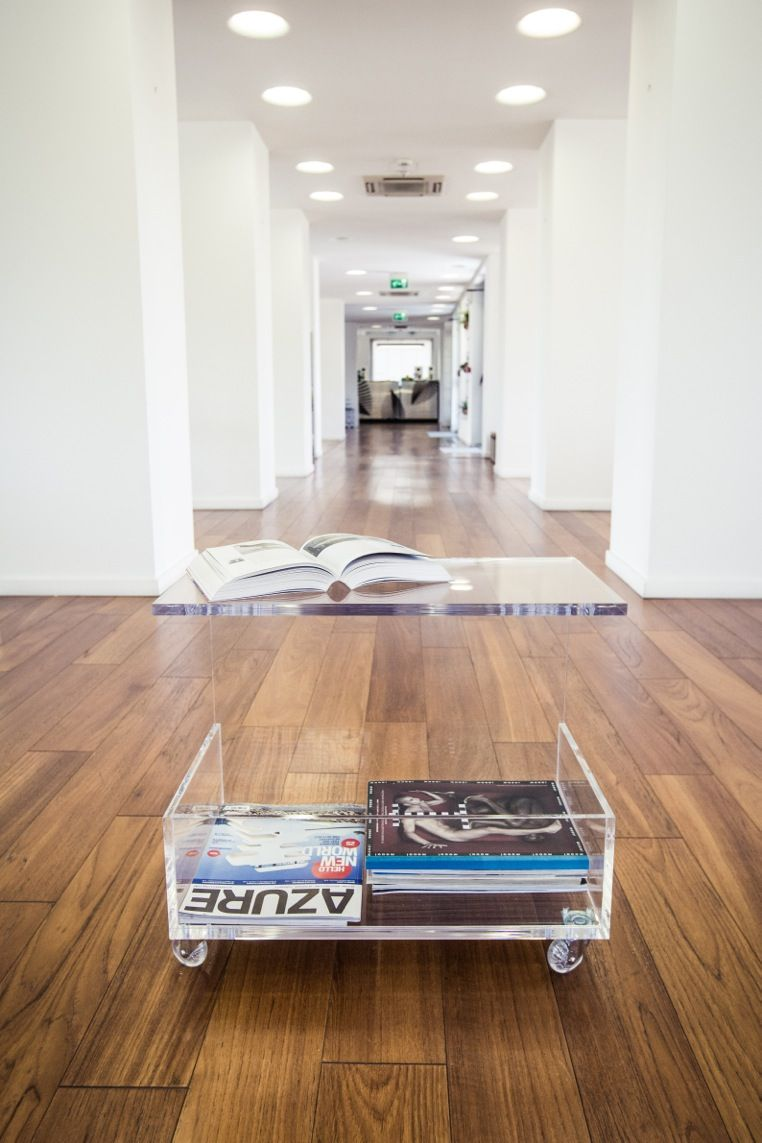 Clear acrylic coffee table with magazine rack. #design # ...