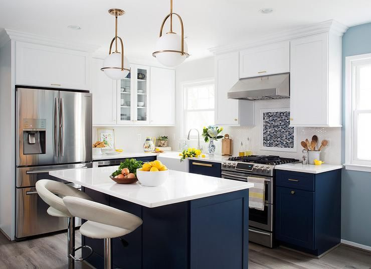 White And Gold Pendant Lights Over A Navy Blue Island Finished