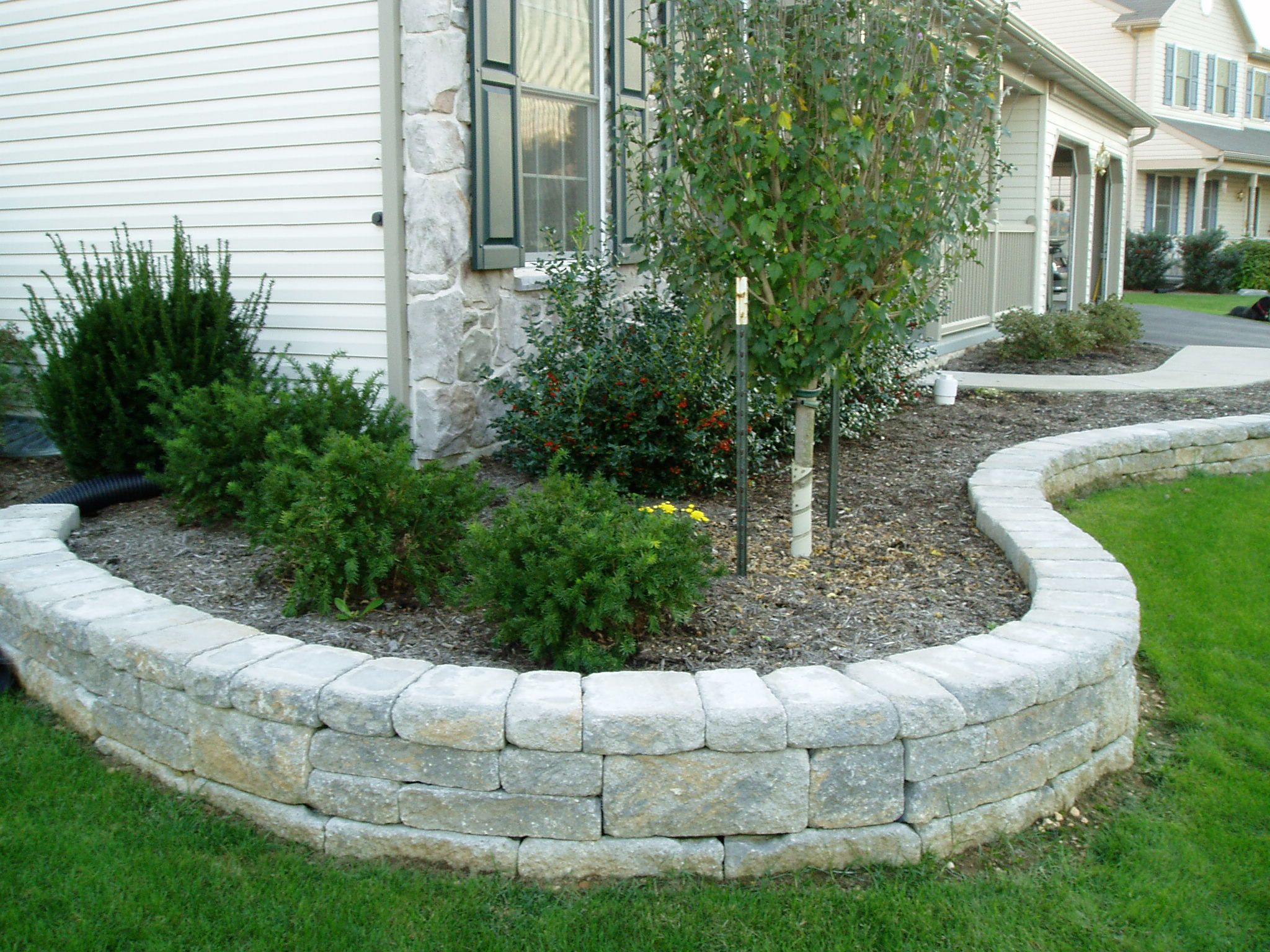 Landscaping outdoor space pinterest landscaping for Stone wall landscaping ideas