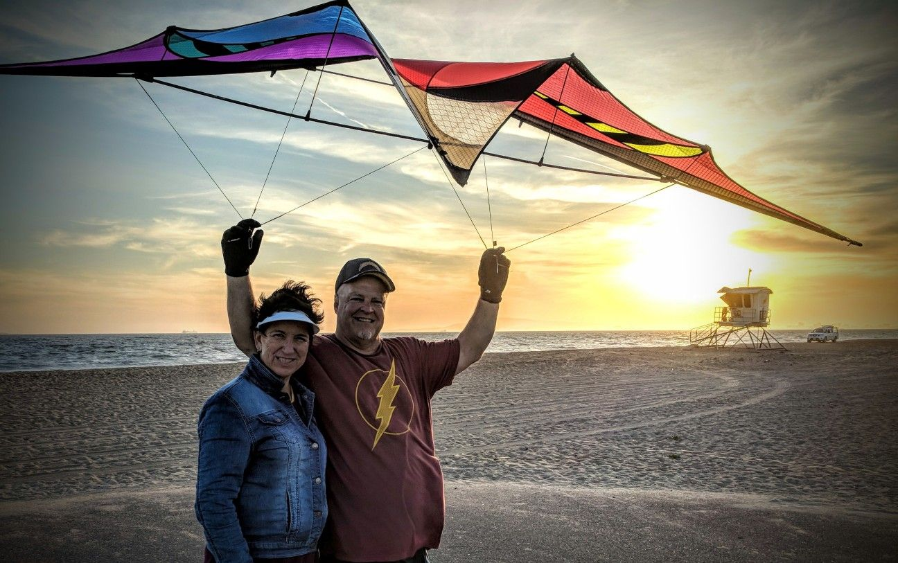Flying a kite in a sunset General contractor, Beach fun
