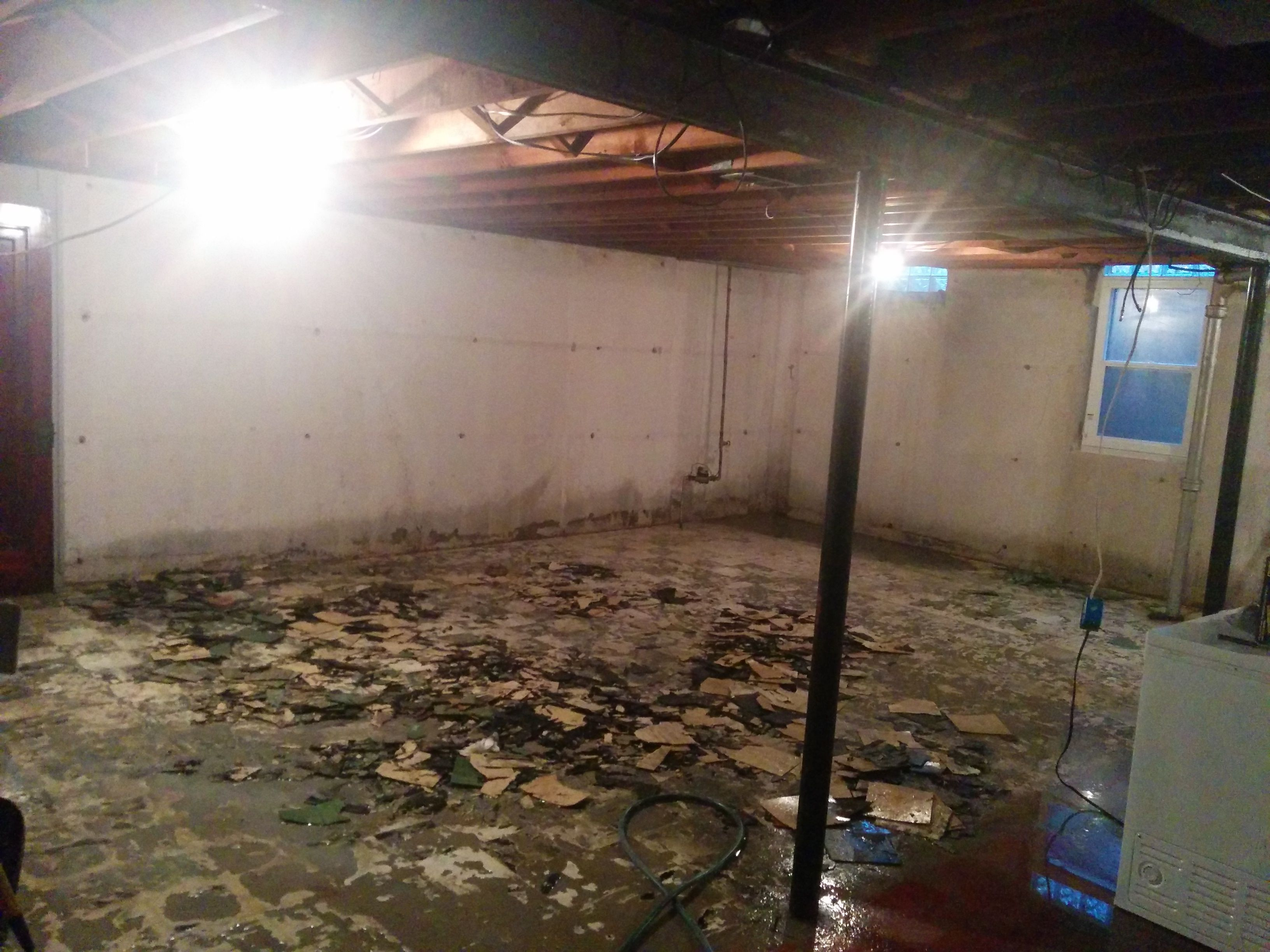 Broken Asbestos Tile Hosed Down With Water To Prevent Dust This By Far Was The Most Difficult Task Asbestos Tile Basement Remodeling Prevention