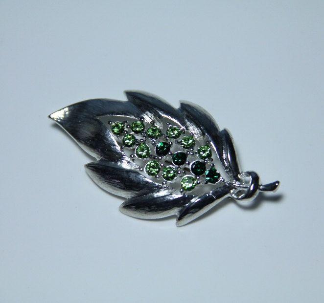 Vintage J.J. Silver-tone Leaf Brooch with Green Jewels. $20.00, via Etsy.