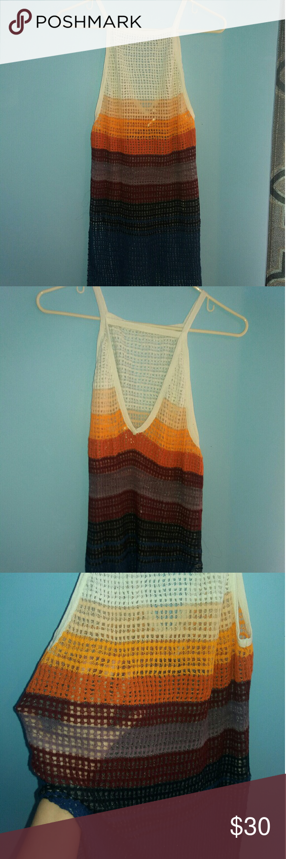 Colorful Free People Top Colorful, v-dip on the back, sheer/knit  ✅ Offers Considered ☺  ✅ Bundle Discounts   ✅ Please use the blue 'offer' button to submit an offer  ✅ Hate paying more for shipping than the actually item? Try to bundle! The more you bundle I will help you out with a higher discount percent!  ✅ All pieces are lightly used Free People Tops Tank Tops