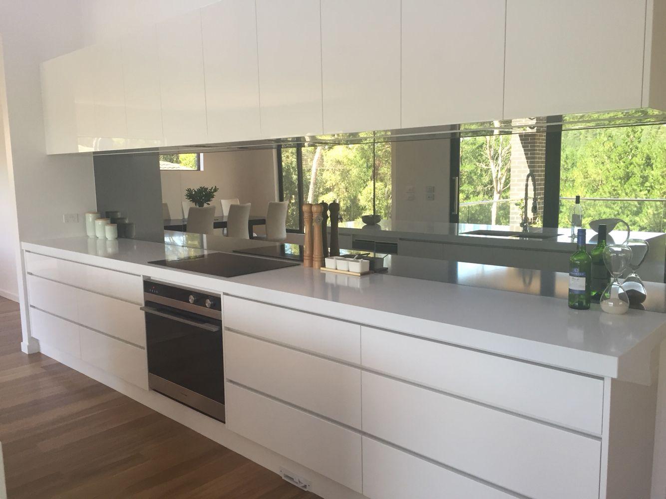 White Kitchen Mirror Splashback mirror splashback kitchen with white push open doors no handles