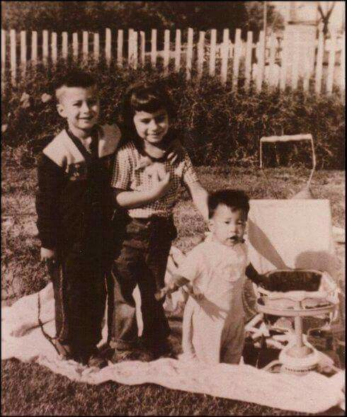Steve as a young boy, w/ possibly cousins?